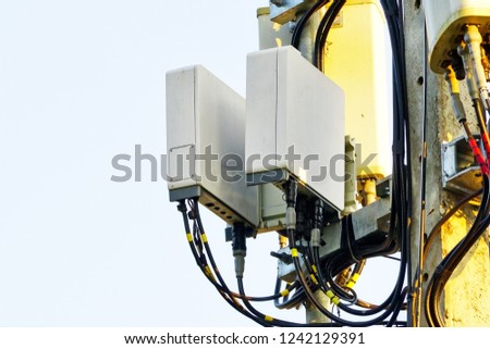 Micro cellular 3G, 4G, 5G. Base Station or Base Transceiver Station. Wireless Communication Antenna Transmitter. Development of communication system in urban area with sunrise in the morning. #1242129391