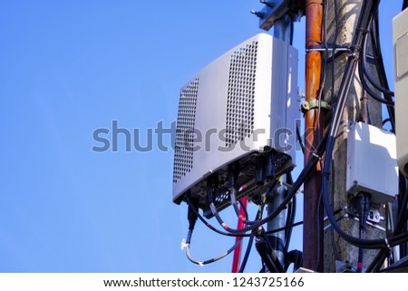 Micro cellular 3G, 4G, 5G. Base Station or Base Transceiver Station. Wireless Communication Antenna Transmitter. Development of communication system in urban area with blue sky. #1243725166