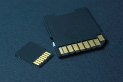 micro sd cards lie on a black background.