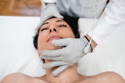 Micro sensory electrical BIO EMS micro-current treatment for face and body electrode stimulation with conductive gloves. Anti wrinkle and anti-aging lifting. Selective focus.