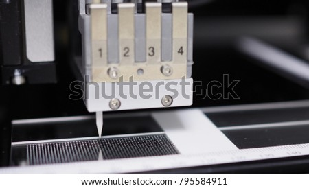Microarray printing on glass slide, non-contact printing system, selective focus on tip and spots on glass slide