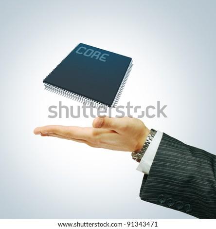 Microchip on businessman hend - stock photo