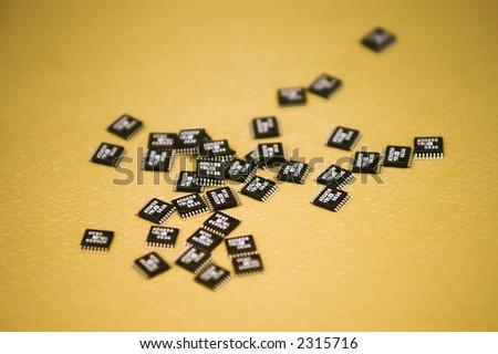 Microchips - A heap of microchips lying on a table.