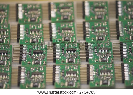 Microchips - A stack of microchips lying on a table.