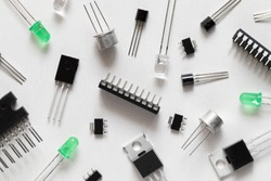 Microcontrollers, transistors, green LEDs, microcircuits, thyristors on a white background. Radio Components