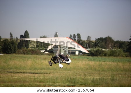 Microlight taking off from a grass runway