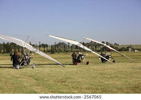 Microlights parked on a grass runway