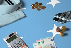Micronesia flag on minimal money concept table. Coins and financial objects on flag surface. National economy theme.