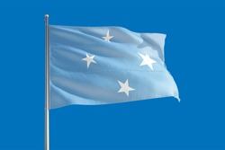 Micronesia national flag waving in the wind on a deep blue sky. High quality fabric. International relations concept.