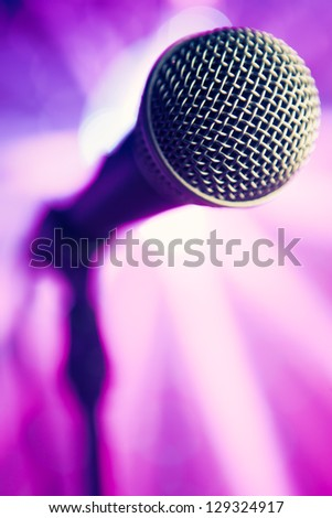 microphone against purple rays background