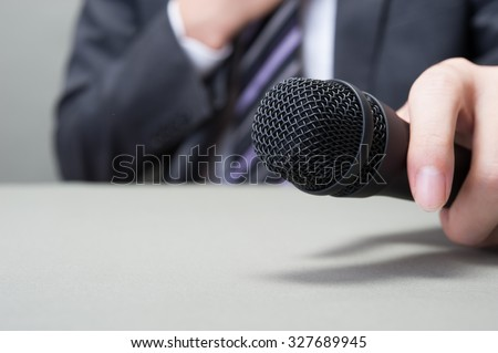 Microphone and businessman #327689945