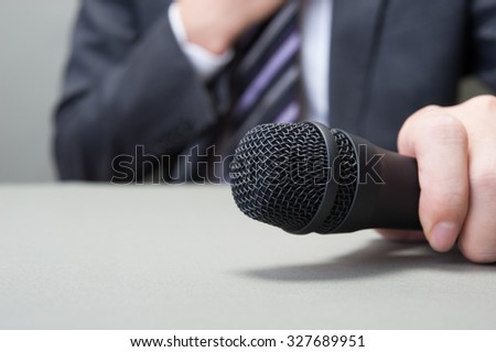 Microphone and businessman #327689951