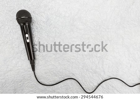Microphone and cable on white background