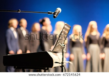 Microphone and music stand in front of electric pianos on the stage of the theater Stock photo ©