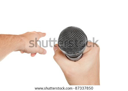 Microphone in a hand and other hand pointing forward isolated on white background