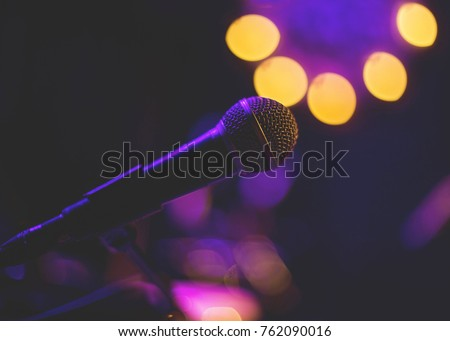 Microphone in low light. #762090016