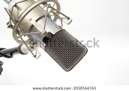 Microphone in Shock Mount (anti-Vibrate) on Stand, Upside Down, Isolated on White