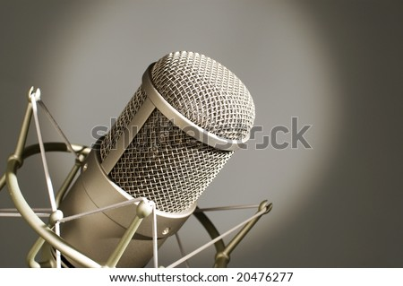 Microphone in studio on a light background.