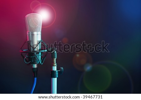 Microphone in the night colorful light in a recording studio [Photo Illustration]