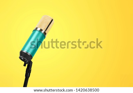 microphone isolated on Yellow background (Mic, condencer Mic, Voice Mic, Instrument Mic, Studio Mics, Microphones, condencer Microphone, Voice Microphone, Instrument Microphone, Studio Microphones