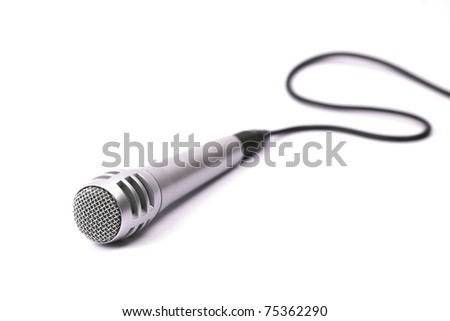 Microphone, isolated, with cord. Selective focus on the front mesh