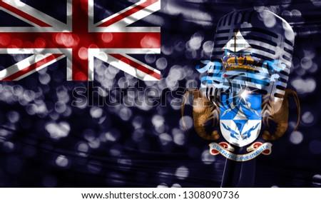 Microphone on a background of a blurry Tristan da Cunha flag close-up #1308090736
