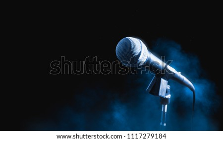 microphone on a dark background with smoke