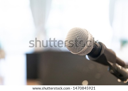 Microphone on abstract blurred of speech in  room or speaking conference Event Background  #1470845921