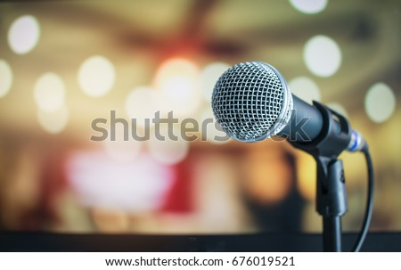 Microphone on abstract blurred of speech in seminar room or speaking conference hall light, Event Background #676019521