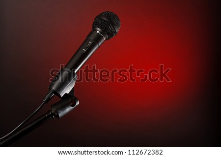 Microphone on red background