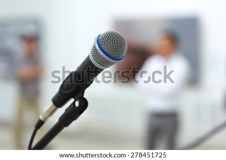 microphone on stage in front of the crown #278451725