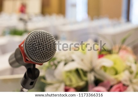 Microphone on the stage in the ballroom. It is for lecturer, presenters, speakers in meetings, seminars or training. #1173366316