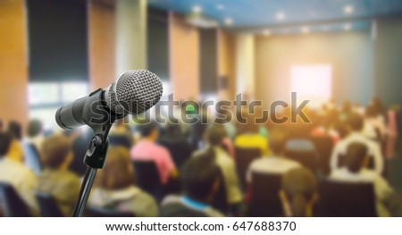 Microphone over the blurred business people forum Meeting Conference Training Learning Coaching Concept, Blurred background