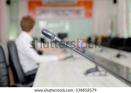 Microphone soft focus on blur abstract background lecture hall
