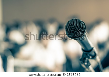 Microphone soft focus on blur abstract background lecture hall/ seminar meeting room in business event educational academic classroom training course: Speaker / teacher\'s mic in college class room