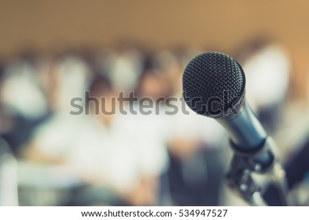 Microphone soft focus on blur lecture hall/ seminar meeting room background in business event/ educational academic classroom training course: Host speaker / teacher's mic in college study class room