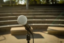 Microphone Stand in Empty Amphitheater with No People Outside at Sunset for Comedy Show or Live Entertainment