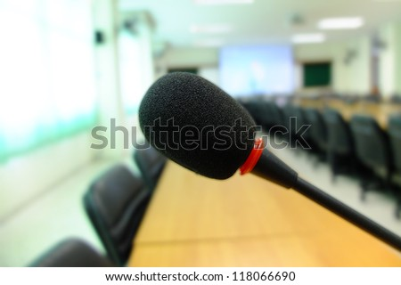 Microphone stands on meeting room table