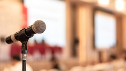 Microphone voice speaker in business seminar, speech presentation, town hall meeting, lecture hall or conference room in corporate or community event for host or public hearing