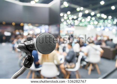Microphone with abstract blurred photo of conference hall or seminar room with attendee and bokeh, Business meeting concept. #536282767