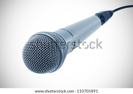 microphone with black wire isolated on white