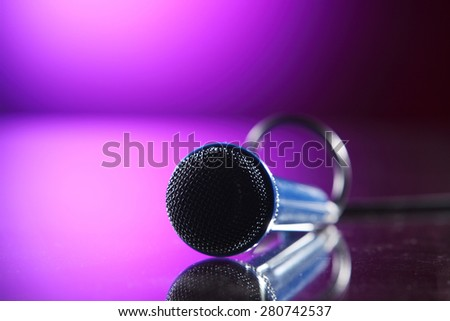 microphone with cable on the purple background