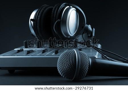 Microphone with mixer and headphones - music studio set