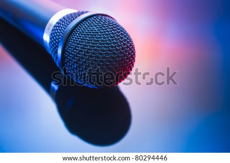 microphone with reflection in mixed red blue light