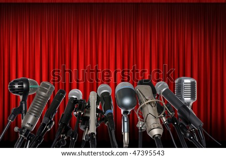 Microphones in front of red curtain - stock photo