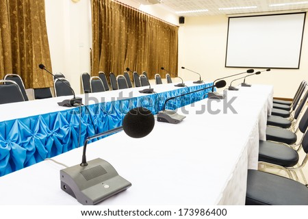 Microphones on table in a conference room