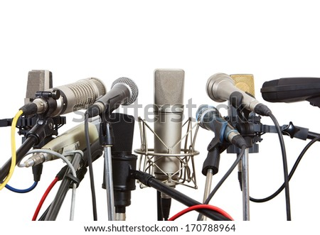 Microphones prepared for conference meeting isolated on white