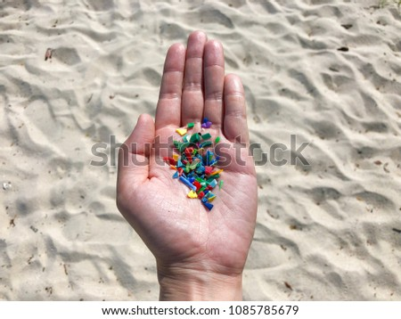 Microplastics picked up on a beach #1085785679