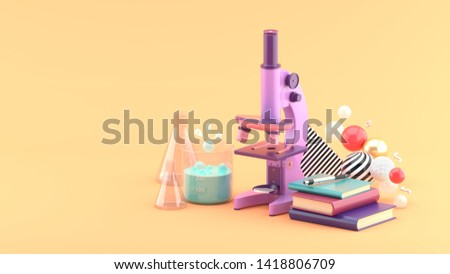 Microscopes, books and test tubes amidst colorful balls on an orange background.-3d rendering. stock photo