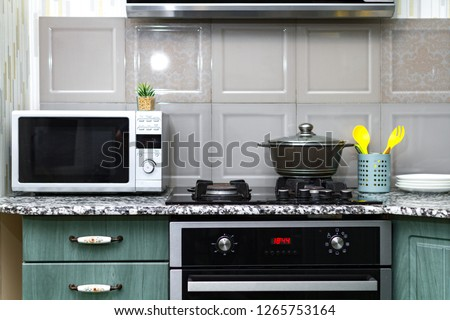 Microwave in the kitchen. Using the microwave oven to heat food